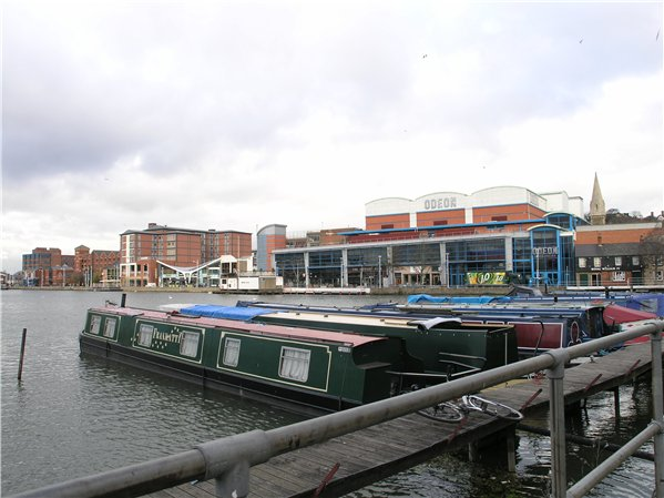 Canal boats on the Brayford Pool. Leisure uses such as the cinema and restaurants can be seen behind on Brayford Wharf North.