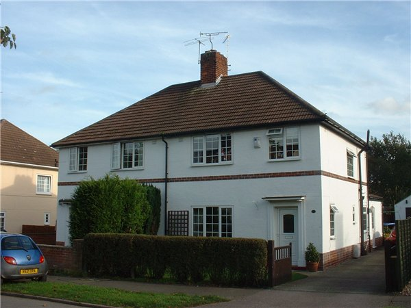 Semi-detached house located on Hartshome Drive, with front garden and ...