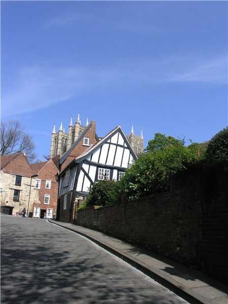 Crowning effect of Lincoln Cathedral over buildings at the top of Michealgate.