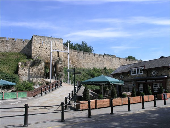 Public open space in front of the west gate of the Castle. The area is paved with a pathway leading up to the Castle.