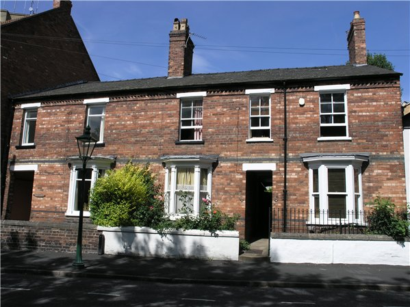 Short terraced of Late Victorian/Edwardian houses with shared entrances along Westgate. The properties each have bay windows on the ground floor with lintels above windows and the access to the shared entrance.