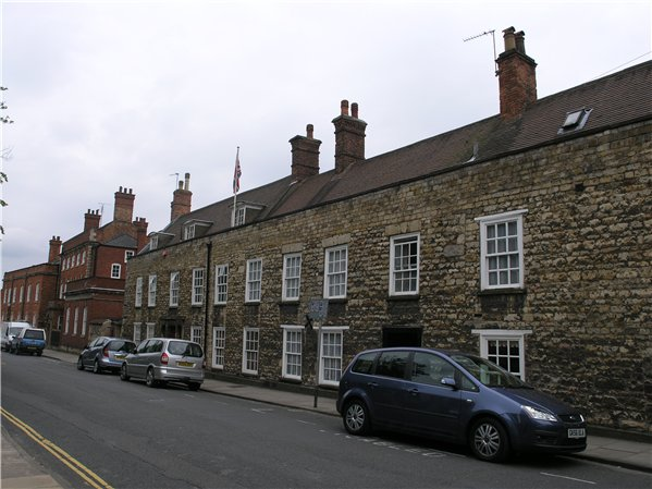 Two and three storey buildings along Eastgate built using stone and redbrick.