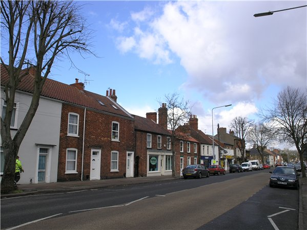 Row of terraced properties along the west side of Newport composed of several build units, illustrating the plot-by-plot development of the Character Area