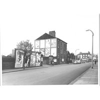 Canwick Road in 1954, looking towards the Durham Ox Crossing, with the entrance to Canwick Square just beyond the building in the centre. This part of Canwick Road is now a cul-de-sac close to Pelham Bridge