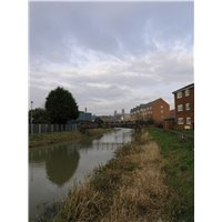 View looking north along the River Witham from Foster Street. Showing modern public apartment blocks at Gaunt Street on the immediate right, and the recent development at Riverside Drive is centre right.