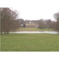 View of Riseholme Hall across ornamental lake